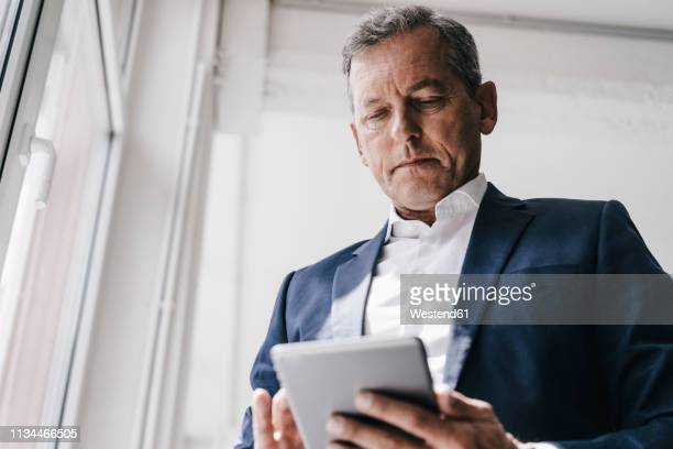 businessman using cell phone - high society stock pictures, royalty-free photos & images