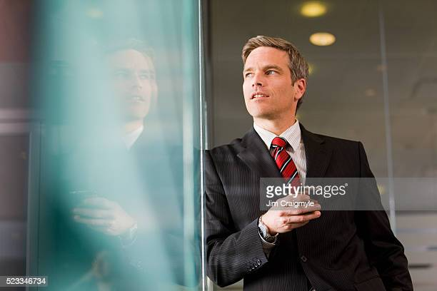 businessman using cell phone - jim craigmyle stock pictures, royalty-free photos & images