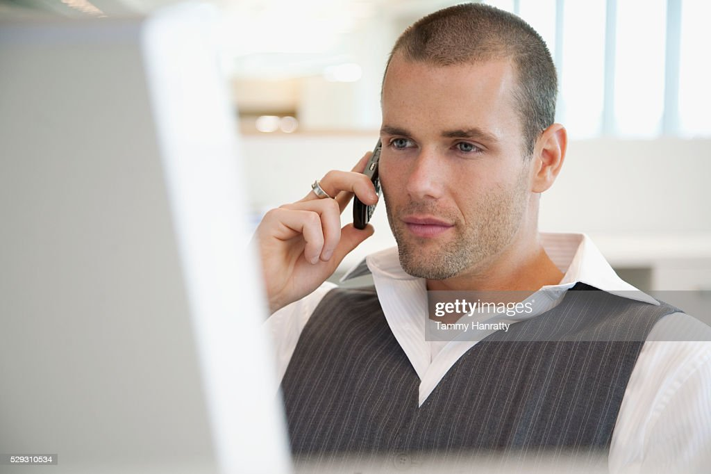Businessman using cell phone : Stock Photo