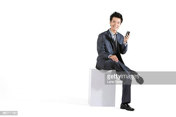 businessman using cellphone - よそいきの服 ストックフォトと画像