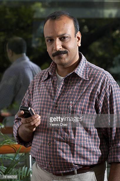 Businessman using cellphone, portrait