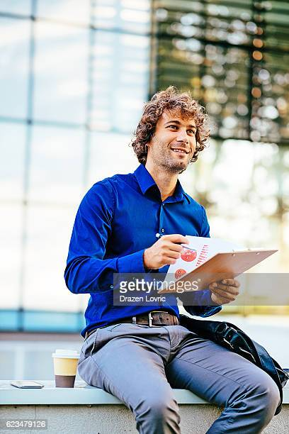 Businessman using coffee break for data analysis
