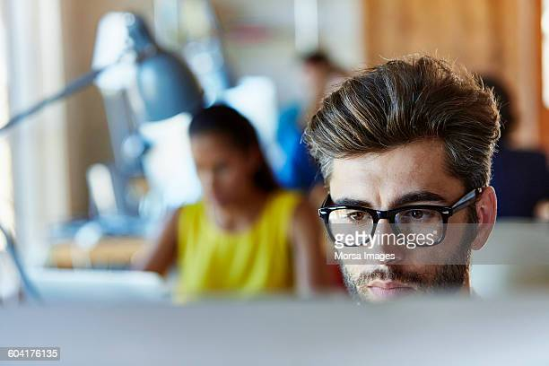 businessman using computer in creative office - 20 29 years stock pictures, royalty-free photos & images