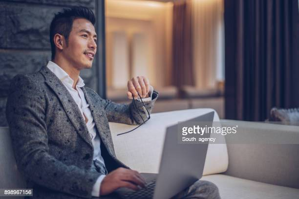 businessman using computer - east asia stock pictures, royalty-free photos & images