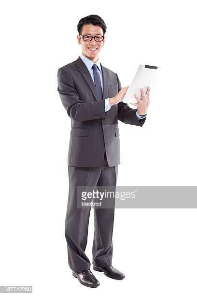 実業家のタブレットコンピューターを使用し