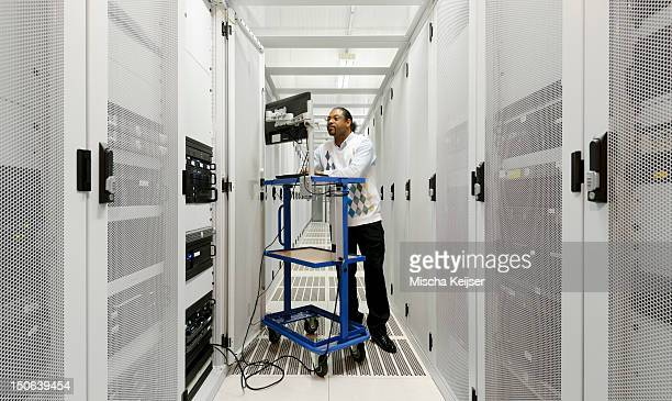 businessman using computer with servers - noord holland stockfoto's en -beelden