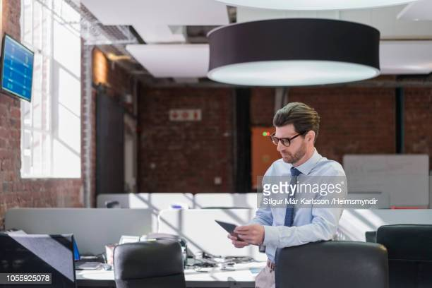 Businessman using digital tablet at office