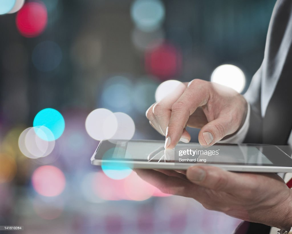 Businessman using digital tablet, close up : Stock Photo