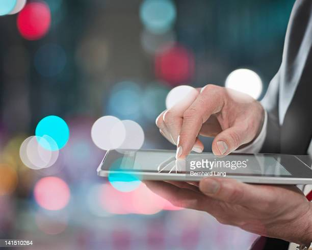 Businessman using digital tablet, close up