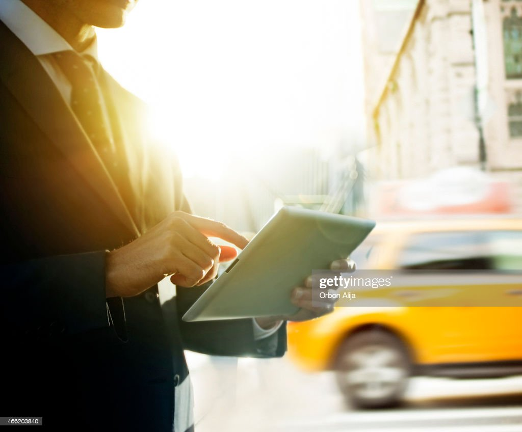 Businessman using digital tablet in New York : Stock Photo