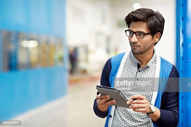 Businessman using digital tablet in warehouse