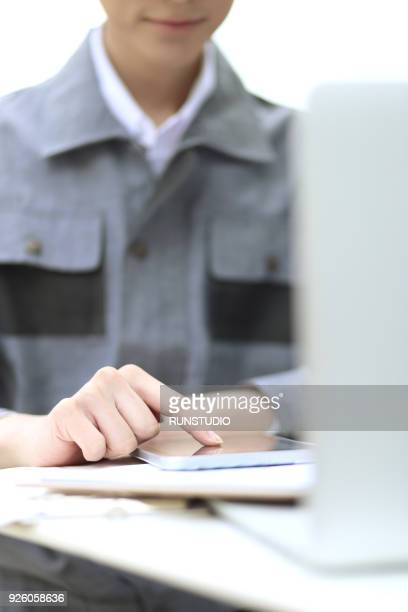 Businessman using digital tablet on desk