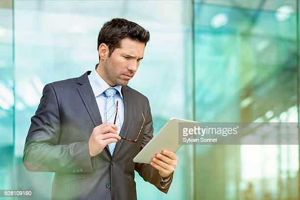 Businessman using digital tablet, Paris, France