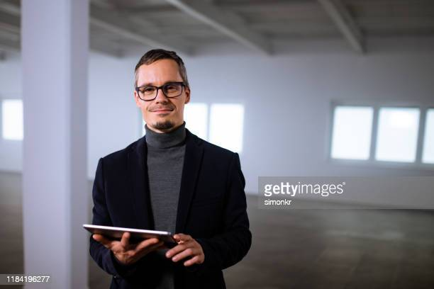 businessman using digital tablet - black hair stock pictures, royalty-free photos & images