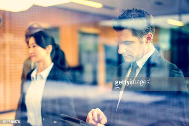businessman using digital tablet - financial analyst stock photos and pictures