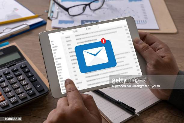 businessman using digital tablet with email notification at office - e mail inbox stock pictures, royalty-free photos & images