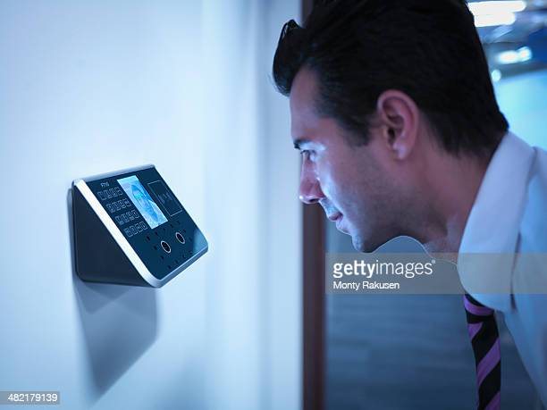 businessman using face recognition system for office security - biometrics stock photos and pictures