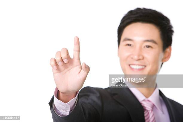 Businessman using finger to point