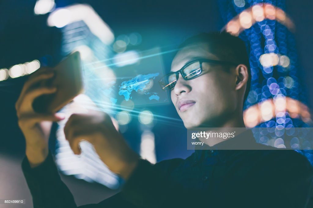 Businessman using futuristic mobile phone : Stock Photo