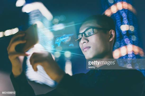 Businessman using futuristic mobile phone