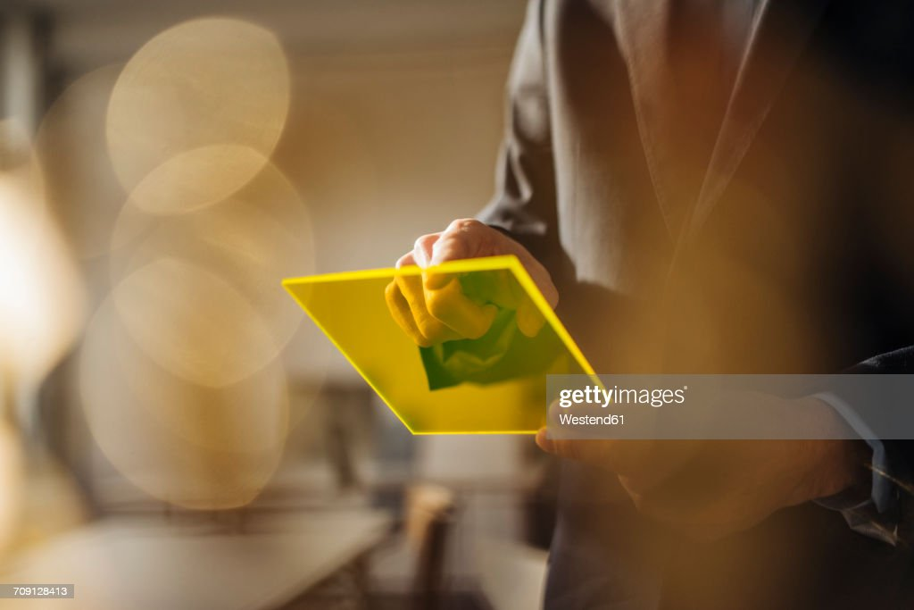 Businessman using futuristic portable device : Stock Photo