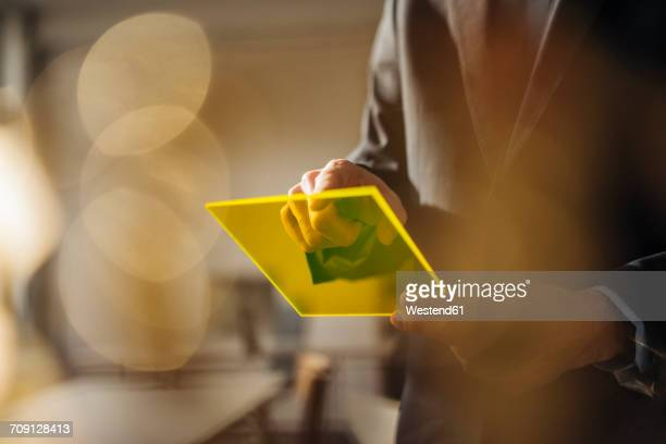 Businessman using futuristic portable device