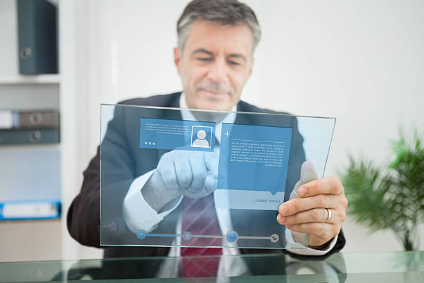 Businessman using futuristic touchscreen to view social media profile