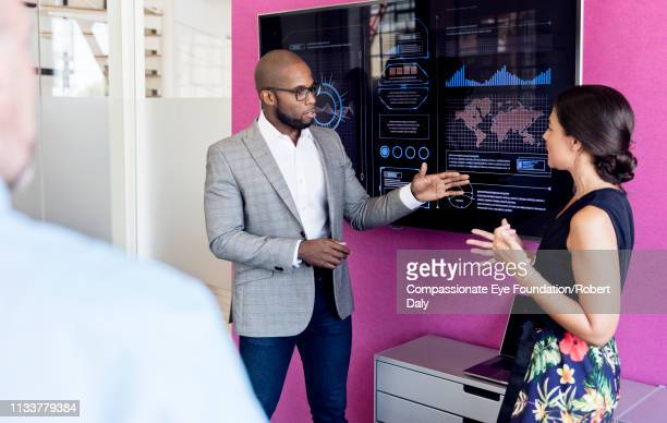 businessman using graphs on screen in meeting - meeting stock pictures, royalty-free photos & images