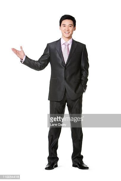 Businessman using hand to show