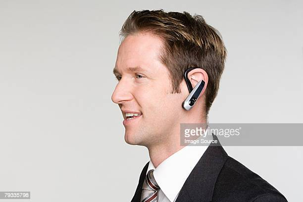 Businessman using hands free device
