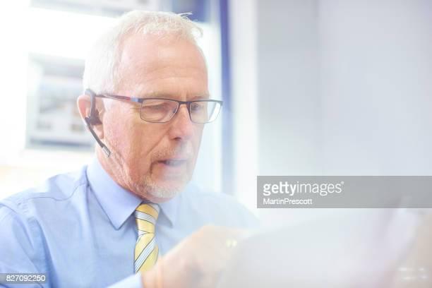 Businessman using headset