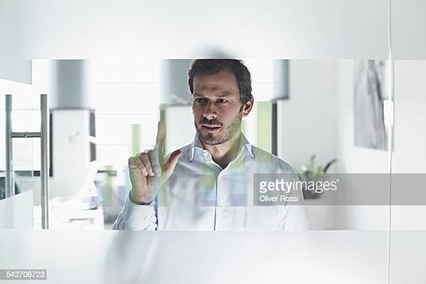 Businessman using interactive screen