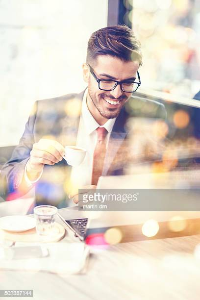 Businessman using lap top in a cafe