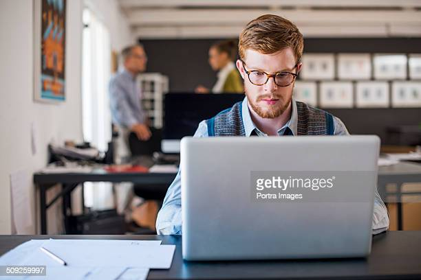 Businessman using laptop at creative office