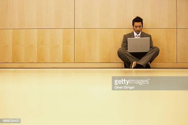 businessman using laptop computer - oliver eltinger stock-fotos und bilder