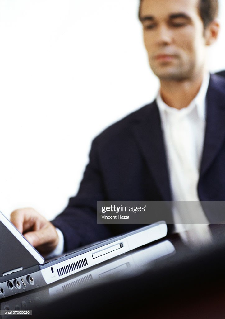 Businessman using laptop computer : Stock Photo