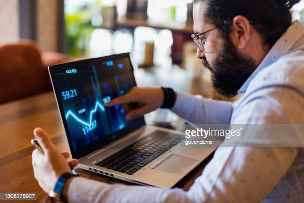 businessman using laptop for analyzing data stock market - stock trader stock pictures, royalty-free photos & images