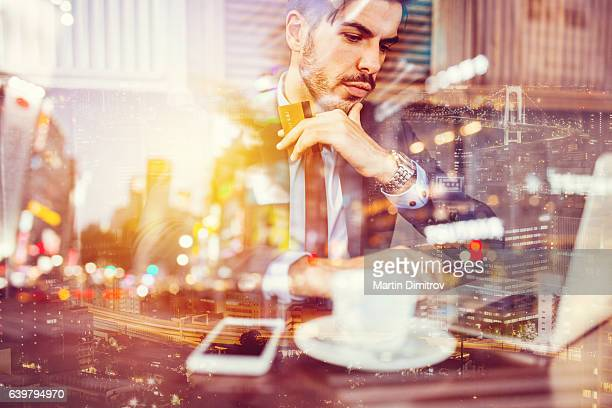 Businessman using laptop for online shopping