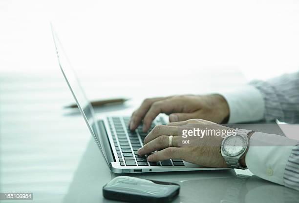 Businessman using laptop,close up