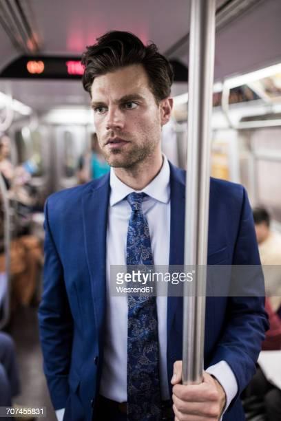 Businessman using metro