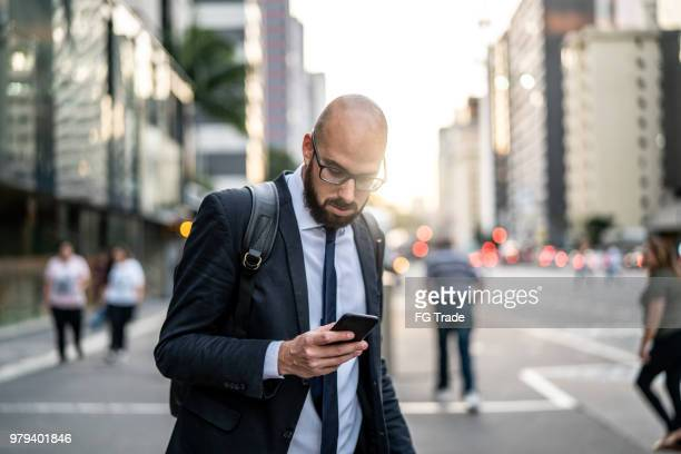 Businessman using mobile at city