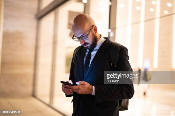 businessman using mobile at night - phone message stock pictures, royalty-free photos & images