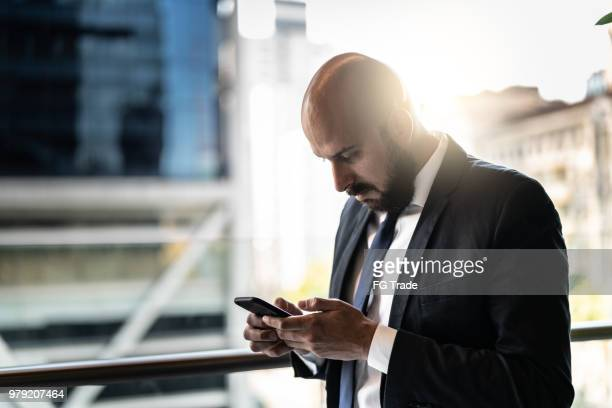 Businessman using mobile at office