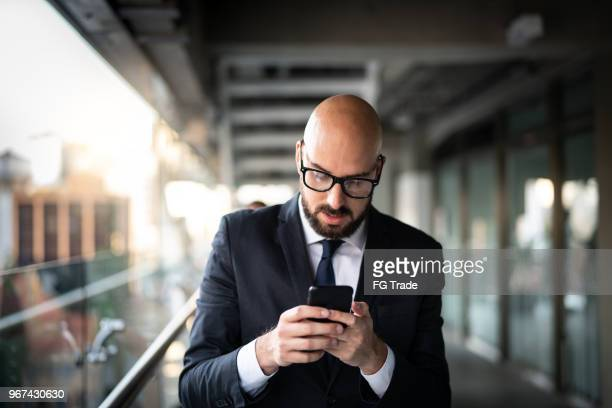 Businessman using mobile on coworking