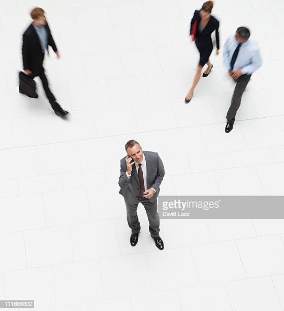 Businessman using mobile, overhead view