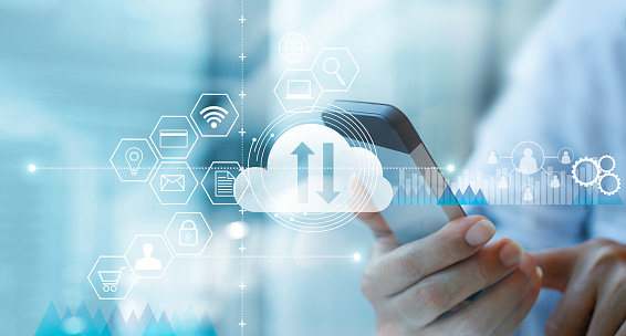 Businessman using mobile smartphone and connecting cloud computing service with icon customer network connection. Cloud device online storage. Cloud technology internet networking concept. 1127257348