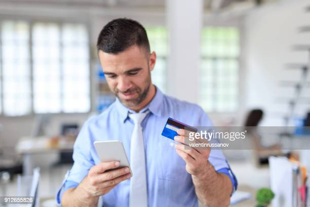 businessman using, mobile telephone and credit card - money transfer stock pictures, royalty-free photos & images