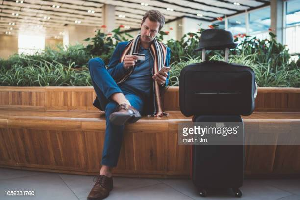 businessman using online banking at the airport - save the date stock pictures, royalty-free photos & images