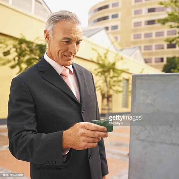 Businessman using parking meter