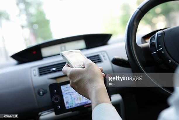 Businessman using PDA in car,close up